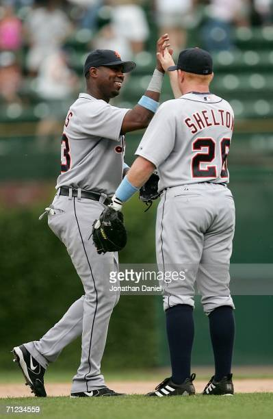 Marcus Thames of the Detroit Tigers congratulates teammate Chris Shelton after the Tigers swept a series against the Chicago Cubs on June 18 2006 at...