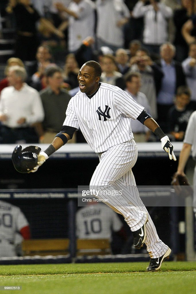 Marcus Thames #38 of the New York Yankees celebrates his two-run walk off home run in the ninth inning to beat the Boston Red Sox on May 17, 2010 at Yankee Stadium in the Bronx borough of New York City. The Yankees defeated the Red Sox 11-9.