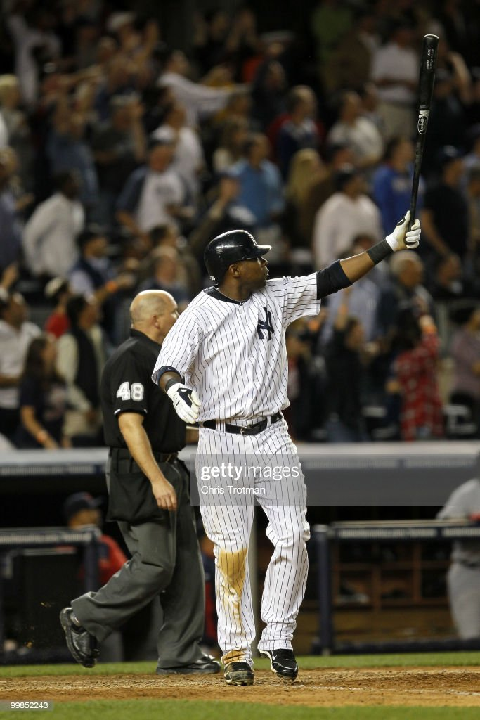 Marcus Thames #38 of the New York Yankees hits a two-run walk off home run in the ninth inning to beat the Boston Red Sox on May 17, 2010 at Yankee Stadium in the Bronx borough of New York City. The Yankees defeated the Red Sox 11-9.