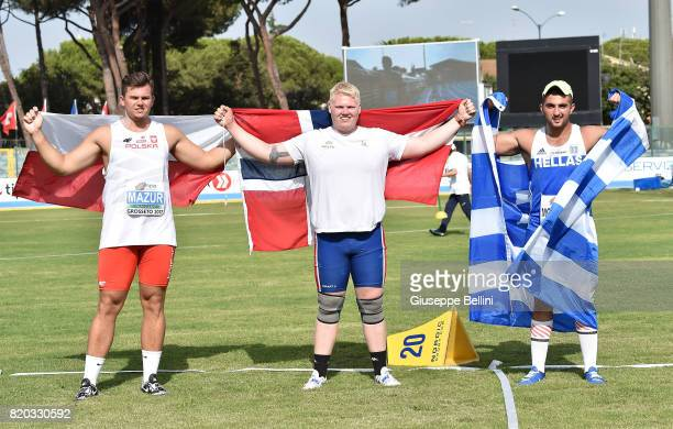 Marcus Thomsen of Norway celebrates the victoty of Shot Put Men with Odisseas Mouzenidis of Greece and Szymon Vazur of Poland during European...