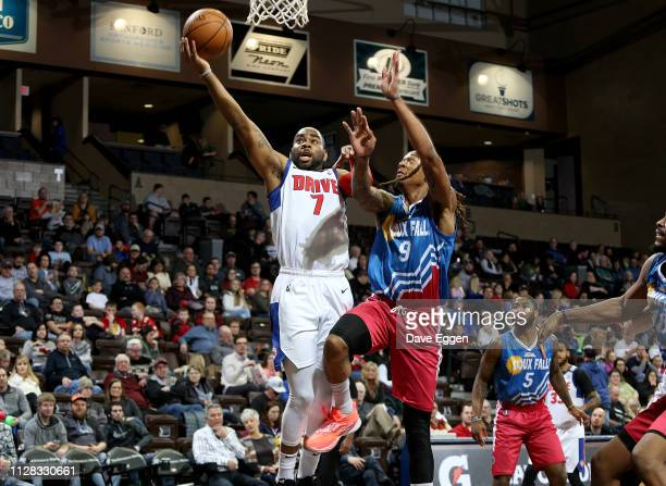 Marcus Thornton of the Grand Rapids Drive takes the ball to the basket against Emanuel Terry of the Sioux Falls Skyforce during an NBA GLeague game...