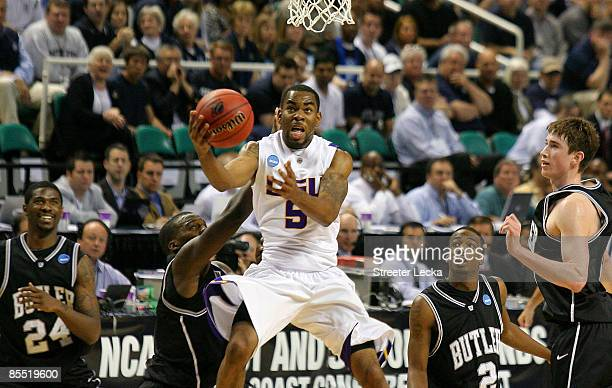 Marcus Thornton of the Louisiana State University Tigers drives through the defense of the Butler Bulldogs during the first round of the NCAA...