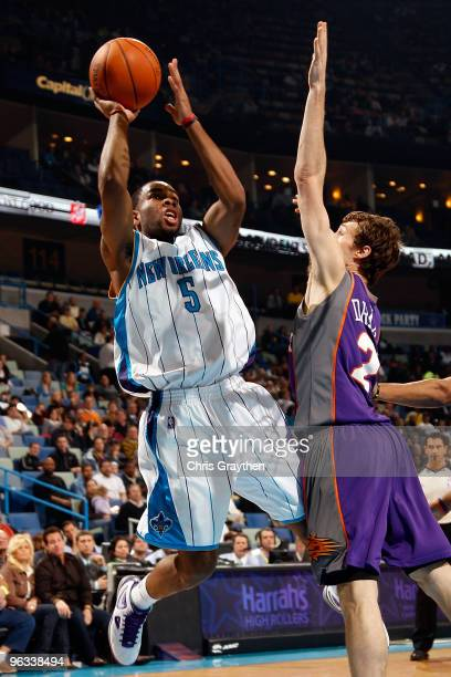Marcus Thornton of the New Orleans Hornets makes a shot over Goran Dragic of the Phoenix Suns at the New Orleans Arena on February 1 2010 in New...