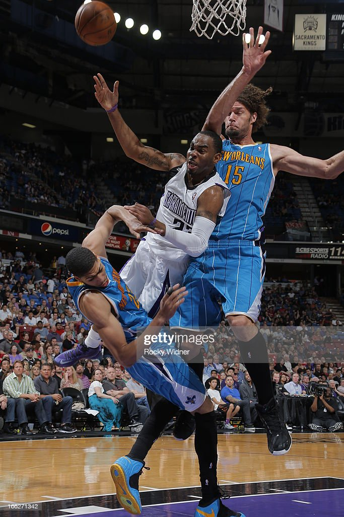 Marcus Thornton #23 of the Sacramento Kings drives the lane against Anthony Davis #23 of the New Orleans Hornets on April 10, 2013 at Sleep Train Arena in Sacramento, California.