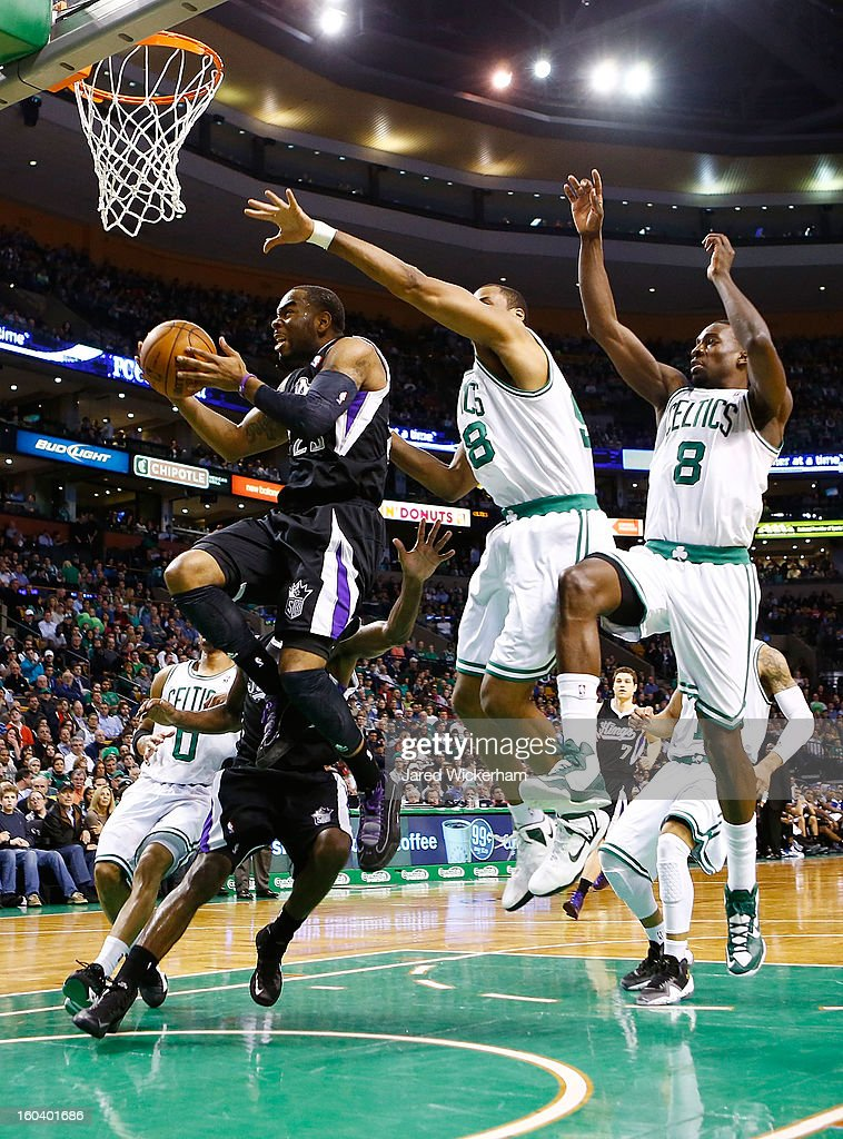 Marcus Thornton #23 of the Sacramento Kings drives to the basket in front of Jason Collins #98 of the Boston Celtics during the game on January 30, 2013 at TD Garden in Boston, Massachusetts.