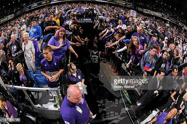 Marcus Thornton of the Sacramento Kings greets fans while heading into the tunnel in a game against the Los Angeles Clippers on April 17 2013 at...