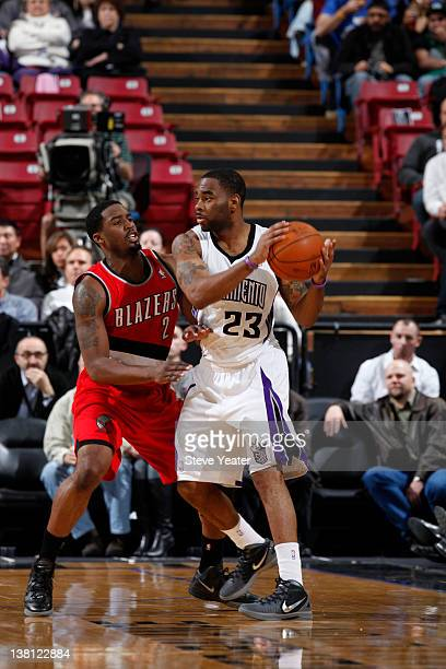 Marcus Thornton of the Sacramento Kings guards the ball against Wesley Matthews the Portland Trail Blazers during a game at Power Balance Pavilion on...