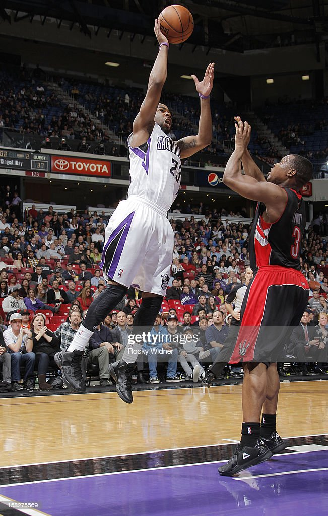 Marcus Thornton #23 of the Sacramento Kings shoots over Kyle Lowry #3 of the Toronto Raptors on December 5, 2012 at Sleep Train Arena in Sacramento, California.