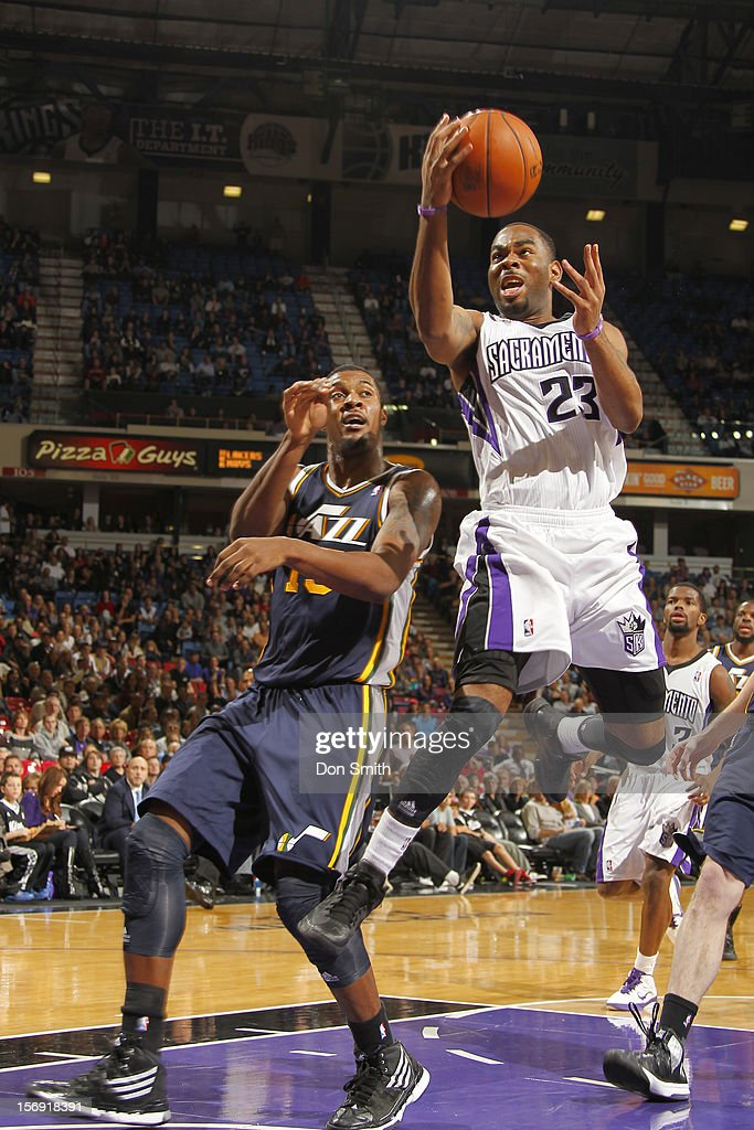 Marcus Thornton #23 of the Sacramento Kings takes the ball to the basket against Derrick Favors #15 of the Utah Jazz on November 24, 2012 at Sleep Train Arena in Sacramento, California.