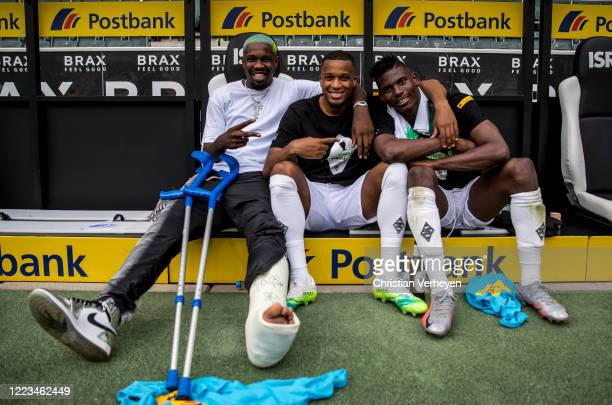 Marcus Thuram Alassane Plea and Breel Embolo of Borussia Moenchengladbach pose for a picture after the Bundesliga match between Borussia...