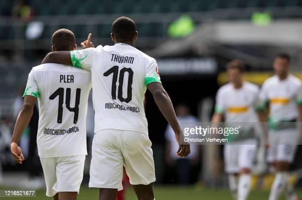 Marcus Thuram and Alassane Plea of Borussia Moenchengladbach celebrate Plea's goal the Bundesliga match between Borussia Moenchengladbach and 1 FC...