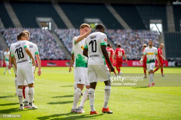 Marcus Thuram and Nico Elvedi celebrate the third goal during the Bundesliga match between Borussia Moenchengladbach and 1 FC Union Berlin at...