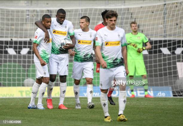 Marcus Thuram celebrates with his team mates after scoring his team's first goal during the Bundesliga match between Borussia Moenchengladbach and...
