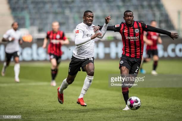 Marcus Thuram of Borussia Moenchengladbach and Evan Ndicka of Eintracht Frankfurt battle for the ball during the Bundesliga match between Borussia...