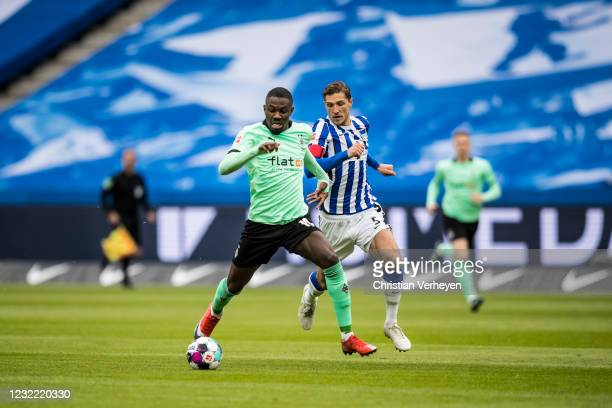 Marcus Thuram of Borussia Moenchengladbach and Niklas Stark of Hertha BSC battle for the ball during the Bundesliga match between Hertha BSC and...