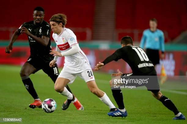Marcus Thuram of Borussia Moenchengladbach, Borna Sosa of VfB Stuttgart and Stefan Lainer of Borussia Moenchengladbach battle for the ball during the...