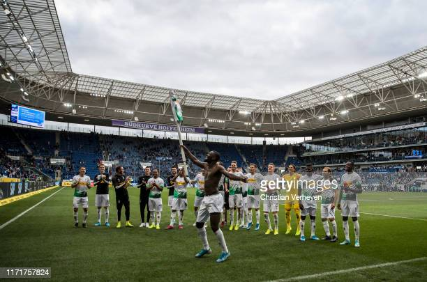 Marcus Thuram of Borussia Moenchengladbach celebrate his teams win with his team mates after the Bundesliga match between TSG 1899 Hoffenheim and...