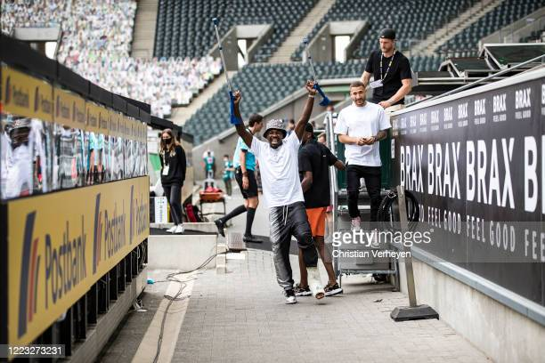 MOENCHENGLADBACH GERMANY JUNE Marcus Thuram of Borussia Moenchengladbach celebrate his Teams win and the Qualification for the Champions League after...