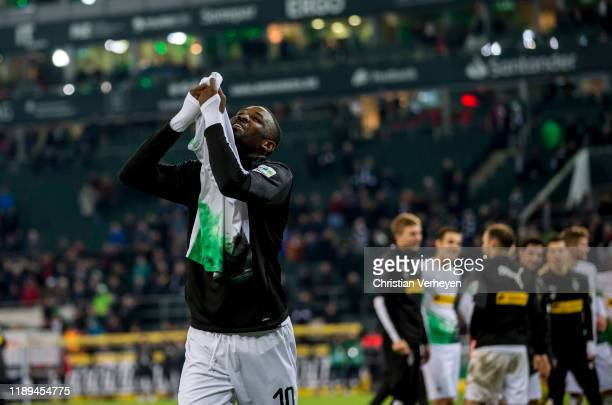 Marcus Thuram of Borussia Moenchengladbach celebrate with the shirt of Alassane Plea after the Bundesliga match between Borussia Moenchengladbach and...