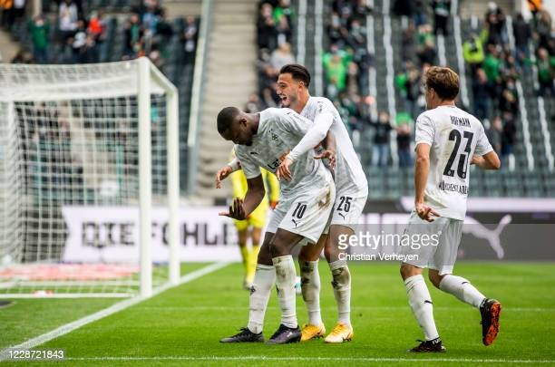 Marcus Thuram of Borussia Moenchengladbach celebrates after he scores his team's first goal during the Bundesliga match between Borussia...