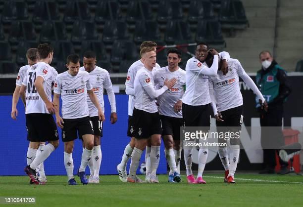 Marcus Thuram of Borussia Moenchengladbach celebrates with Denis Zakaria and teammates after scoring their team's second goal during the Bundesliga...