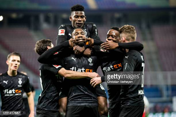 Marcus Thuram of Borussia Moenchengladbach celebrates with teammates after he scoring his team's second goal during the Bundesliga match between RB...