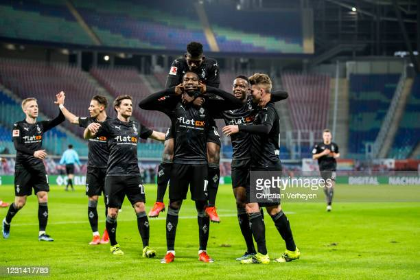 Marcus Thuram of Borussia Moenchengladbach celebrates with teammates after scoring his team's second goal during the Bundesliga match between RB...