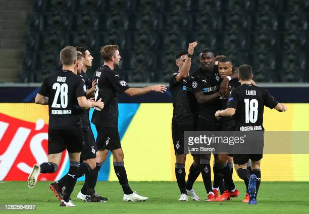 Marcus Thuram of Borussia Moenchengladbach celebrates with teammates after scoring his sides first goal during the UEFA Champions League Group B...