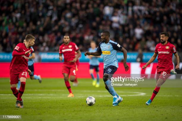 Marcus Thuram of Borussia Moenchengladbach in action during the Bundesliga match between Bayer 04 Leverkusen and Borussia Moenchengladbach at...