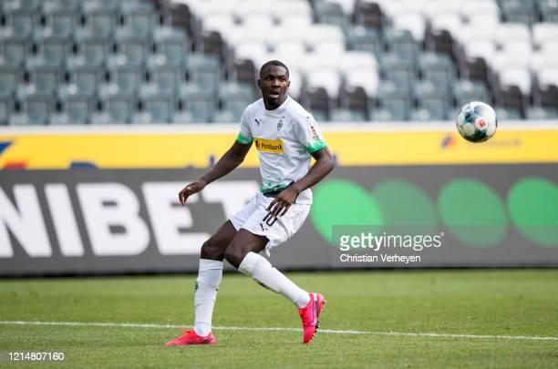 Marcus Thuram of Borussia Moenchengladbach in action during the Bundesliga match between Borussia Moenchengladbach and Bayer 04 Leverkusen at...