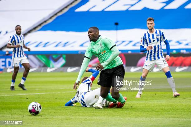 Marcus Thuram of Borussia Moenchengladbach is fouled by Niklas Strak of Hertha BSC leading to a penalty during the Bundesliga match between Hertha...