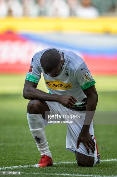 Marcus Thuram of Borussia Moenchengladbach knees down after he score his teams second goal during the Bundesliga match between Borussia...