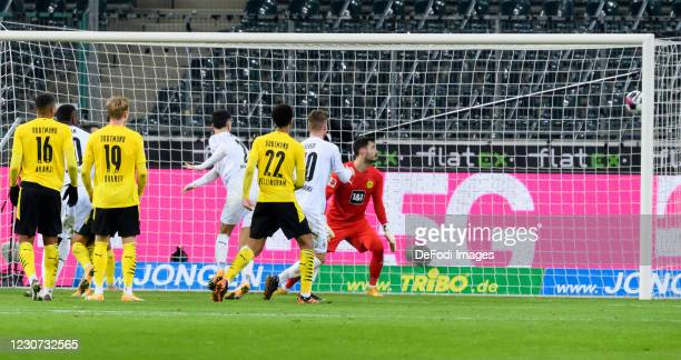 Marcus Thuram of Borussia Moenchengladbach scores his team's fourth goal during the Bundesliga match between Borussia Moenchengladbach and Borussia...
