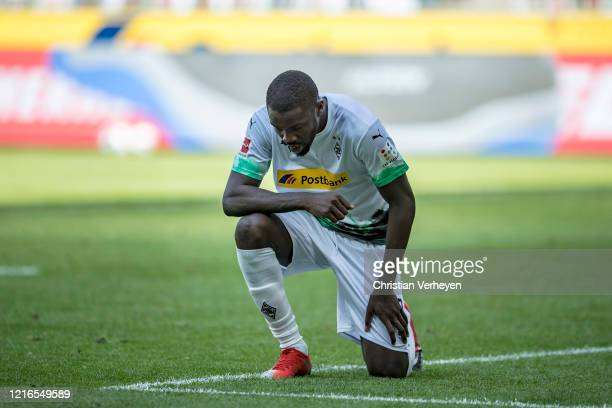 Marcus Thuram of Borussia Moenchengladbach takes a knee after scoring his goal during the Bundesliga match between Borussia Moenchengladbach and 1 FC...