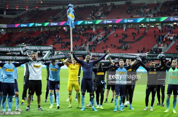 Marcus Thuram of Borussia Monchengladbach and team mates celebrate victory after the Bundesliga match between Bayer 04 Leverkusen and Borussia...