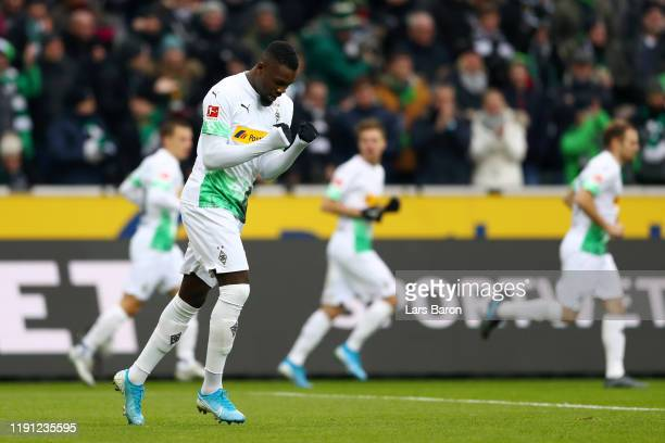 Marcus Thuram of Borussia Monchengladbach celebrates scoring his sides first goal during the Bundesliga match between Borussia Moenchengladbach and...