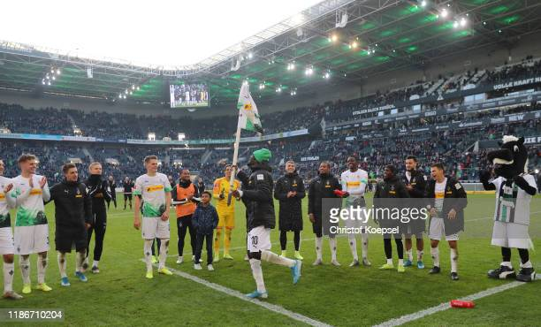 Marcus Thuram of Borussia Monchengladbach celebrates victory with team mates after the Bundesliga match between Borussia Moenchengladbach and SV...