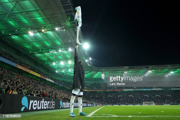 Marcus Thuram of Borussia Monchengladbach celebrates victory with the corner flag after the Bundesliga match between Borussia Moenchengladbach and FC...