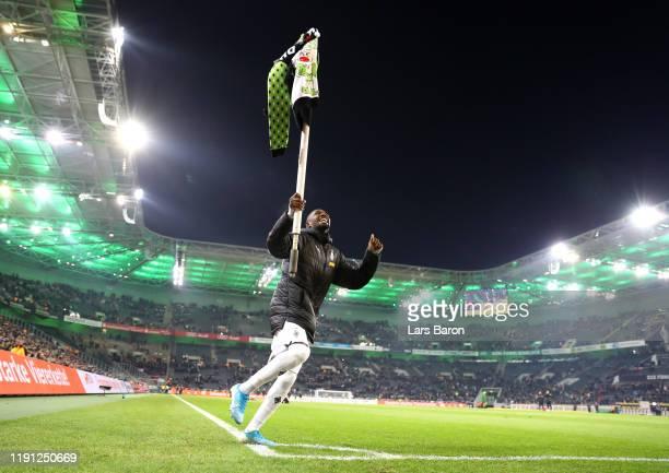 Marcus Thuram of Borussia Monchengladbach celebrates with a corner flag during the Bundesliga match between Borussia Moenchengladbach and SportClub...