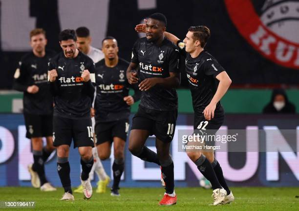 Marcus Thuram of Borussia Monchengladbach celebrates with Florian Neuhaus after scoring his team's first goal during the DFB Cup Round of Sixteen...