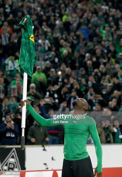Marcus Thuram of Borussia Monchengladbach picks up the corner flag as he celebrates victory during the UEFA Europa League group J match between...