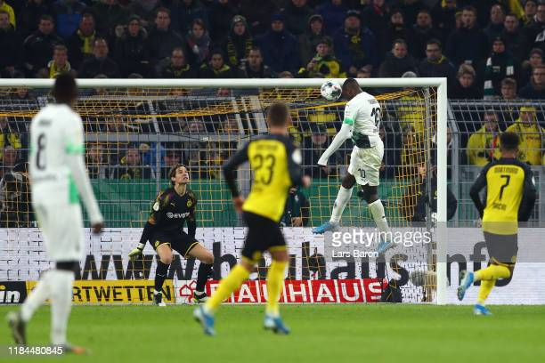 Marcus Thuram of Borussia Monchengladbach scores his team's first goal past Marwin Hitz of Borussia Dortmund during the DFB Cup second round match...