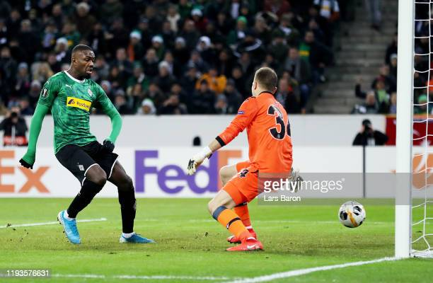 Marcus Thuram of Borussia Monchengladbach scores his team's first goal during the UEFA Europa League group J match between Borussia Moenchengladbach...