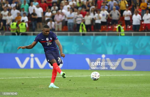 Marcus Thuram of France scores their team's third penalty in the penalty shoot out during the UEFA Euro 2020 Championship Round of 16 match between...