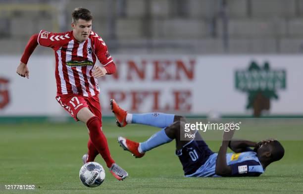 Marcus Thuram of Moenchengladbach and Lukas Kuebler of Freiburg's clash during the Bundesliga match between SportClub Freiburg and Borussia...