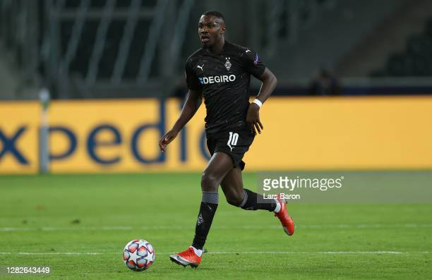 Marcus Thuram of Moenchengladbach runs with the ball during the UEFA Champions League Group B stage match between Borussia Moenchengladbach and Real...