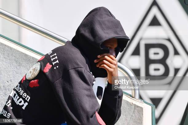 Marcus Thuram watches the training session at Borussia-Park on July 03, 2021 in Moenchengladbach, Germany.