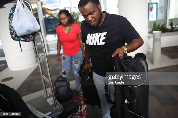 Marcus Thurston and his wife Shenae Thurston cut short their vacation and evacuate the South Bay Inn and Suites hotel ahead of the arrival of...
