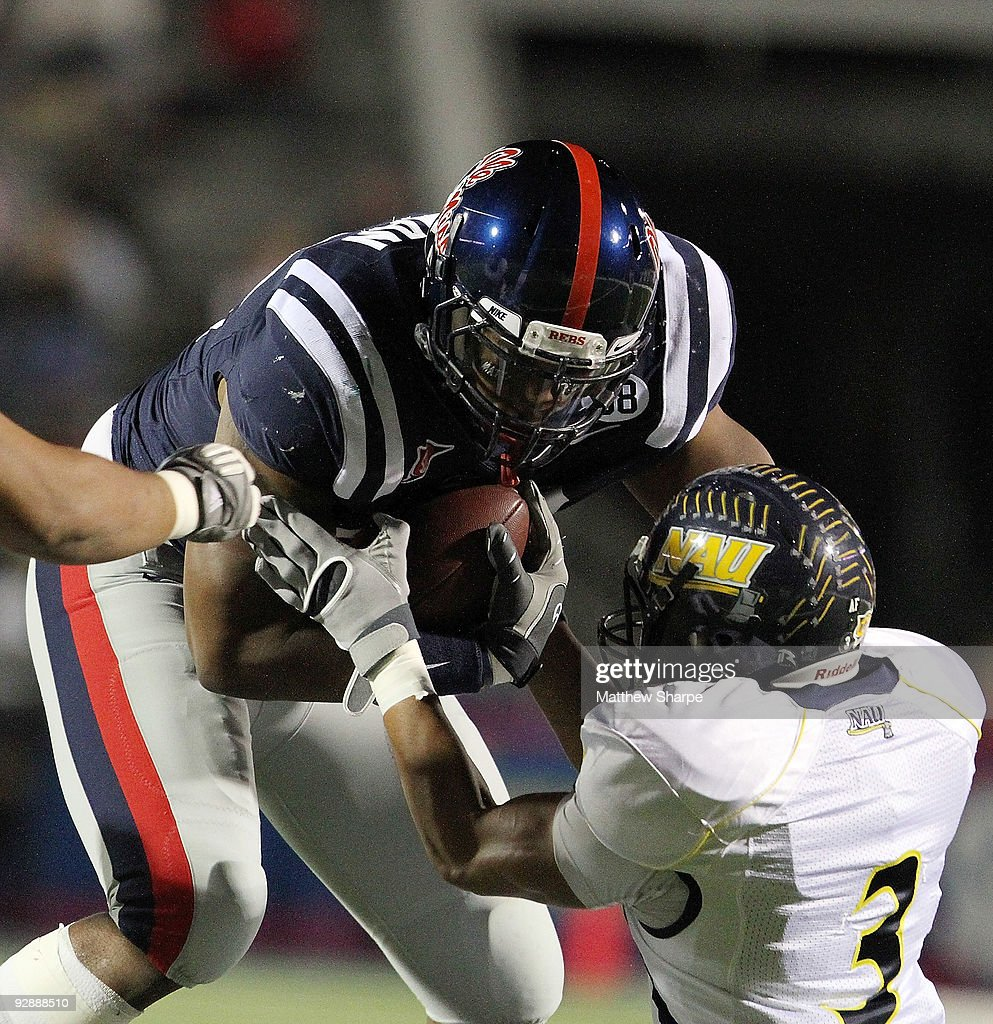Marcus Tillman 92 Of The Ole Miss Rebels Intercepts A Pass Against Northern Arizona