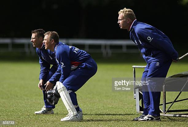 Marcus Trescothick Alec Stewart and Graham Dilley of England during fielding practice in the England cricket nets session at Finchley Cricket Club...